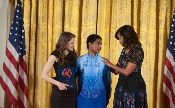 Marie Acemah and Rafael Bitanga receive the National Youth Arts and Humanities Programs Awards at the White House.